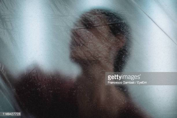 woman seen through plastic - translucent stock pictures, royalty-free photos & images