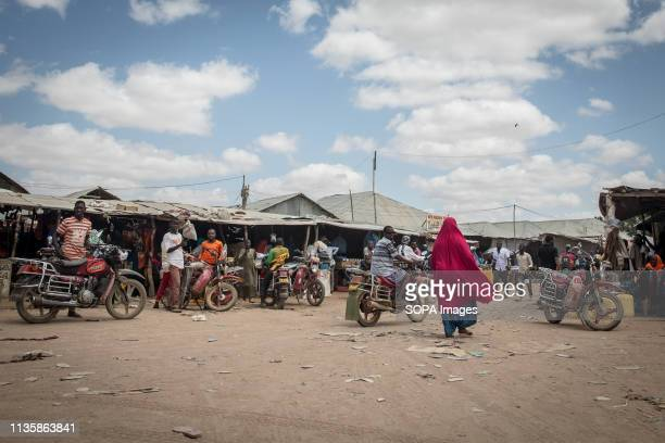 Woman seen walking through a busy street in the refugee camp. Dadaab is one of the largest refugee camps in the world. More than 200,000 refugees...