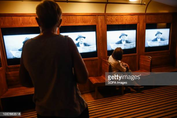 A woman seen watching a movie during the exhibition Exhibition at Oskar Schindler's Enamel Factory museum it is primarily a story about Krakow and...