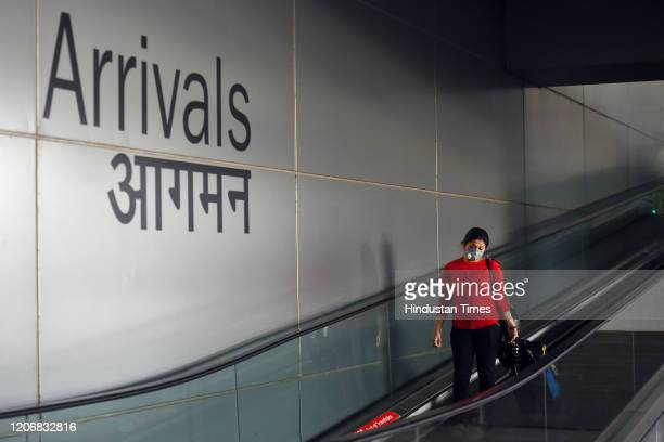 A woman seen wearing a face mask as a preventive measure against the spread of the COVID19 coronavirus at Indira Gandhi International Airport on...
