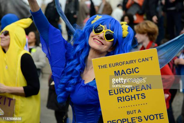 A woman seen wearing a fairy godmother costume seen holding a placard that says The Eurofairy cant magic back your european rights but a peoples vote...