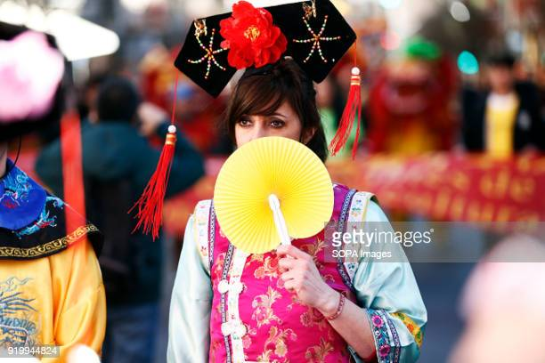 A woman seen wearing traditional Chinese clothes during the chinese new year parade Thousand of participants take part in the Chinese New Year parade...