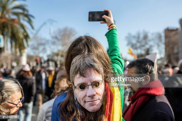 A woman seen with a mask of Carles Puigdemont on her head during a demonstration to support Carles Puigdemont former Catalan President in front of...