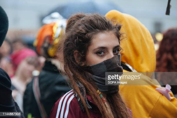 DUOMO MILANO LOMBARDIA ITALY A woman seen with her face half way covered during the protest The feminist movement Non Una di Meno together with other...