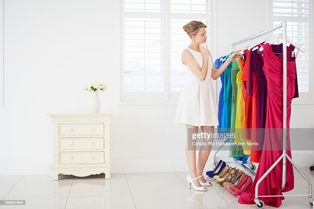 Woman selecting clothes in bedroom : Stock Photo