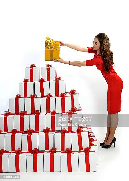 woman selecting the best gift from a pile