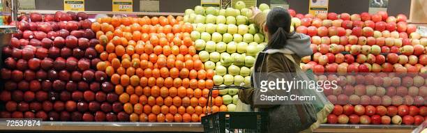 A woman selects apples while shopping in the produce section at Whole Foods January 13 2005 in New York City New eating guidelines issued by the US...