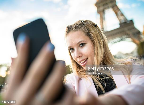 woman self photographing on paris ith the tour eiffel