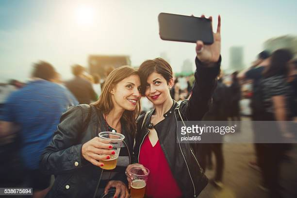 Woman selfie at the summer music festival
