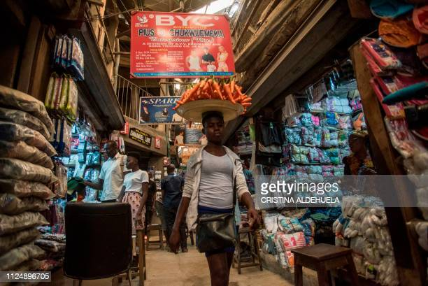 A woman selling carrots walks through the Ariaria International Market in Aba a city in one of the proBiafran separatist regions on February 14 2019...