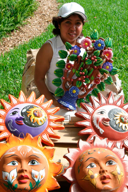 A Woman Selling Ceramics At The Mexico Cinco De Mayo Celebration At