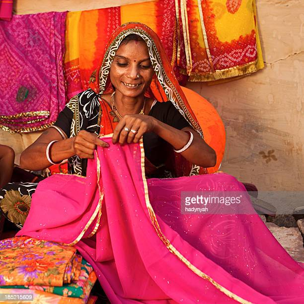 Woman selling colorful fabrics