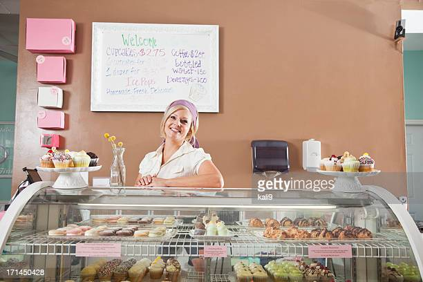 Woman selling cupcakes