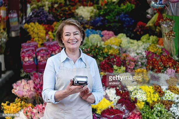 Woman selling flowers at a florist