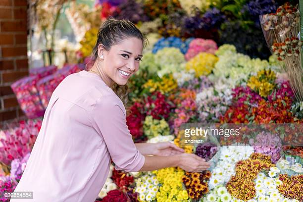 Woman selling flowers at a flower stand