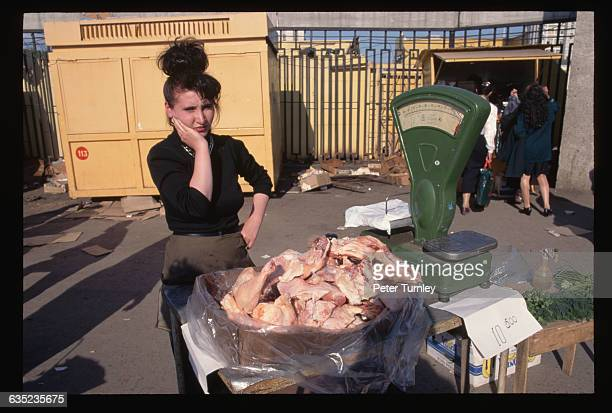 Woman Selling Fowl in Open Air Market