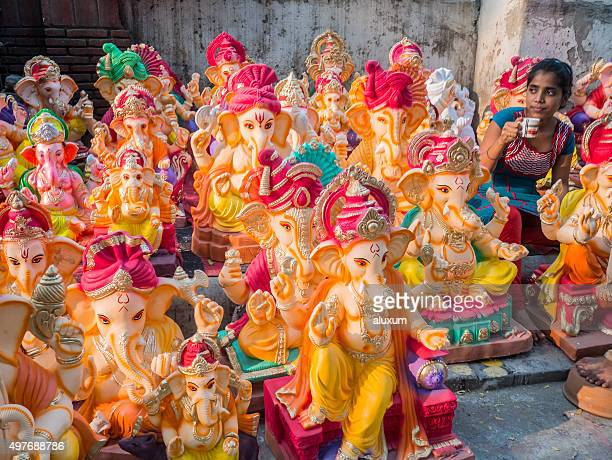 woman selling ganesha statues for ganesh chaturthi india - ganesh chaturthi stock photos and pictures