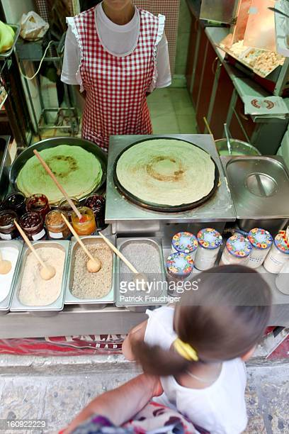 CONTENT] Woman selling pancakes at a snack stand
