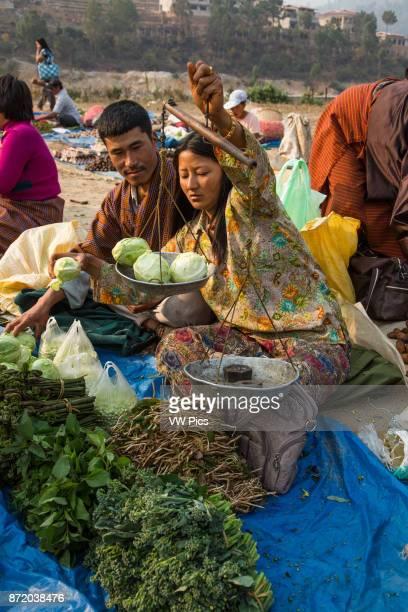 Woman selling produce in the farmers market in Punakha, Bhutan.
