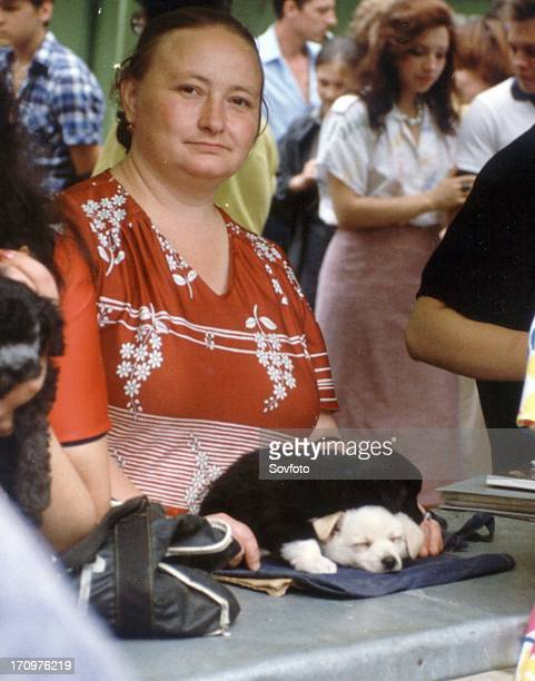 Woman selling puppies at a pet market in moscow 1989