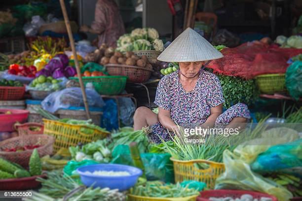 Woman selling vegetables in Hue market, Vietnam