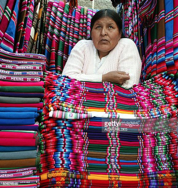 A woman sells 'aguayos' Bolivian typical fabric in La Paz 11 March 2005 With a population of 8724156 inhabitants according to the July 2004 census...