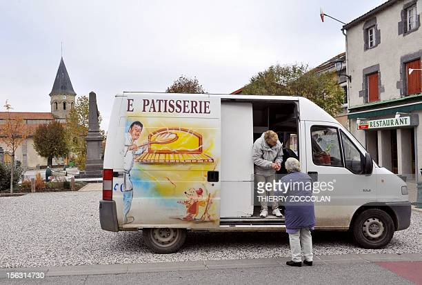 A woman sells bread in a truck used as a mobile bakery on November 13 2012 in VarennesurMorge central France AFP PHOTO THIERRY ZOCCOLAN