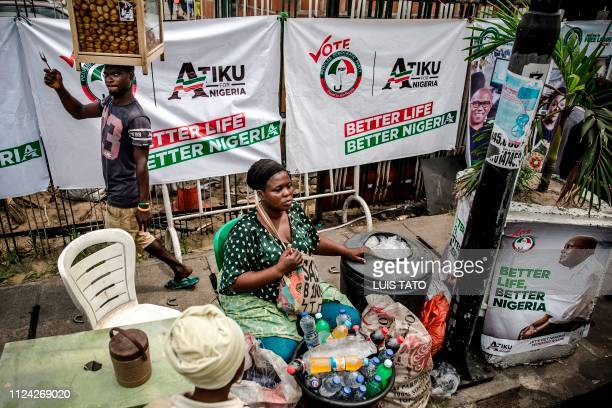 A woman sells drinks as she waits for costumers in Lagos' Tafawa Balewa Square where the People's Democratic Party opposition party is holding a...