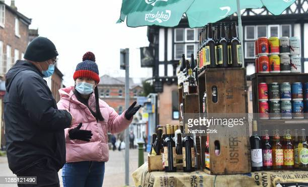 Woman sells drinks at her market stall on November 11, 2020 in Leek, England. The Booksellers Association has called on the government to classify...