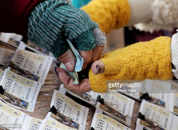 A woman sells El Niño 2020 Lottery tickets on December 23 2019 in Madrid Spain