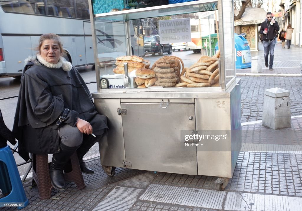 A woman sells fresh-baked in Thessaloniki, Greece, on January 3, 2018.
