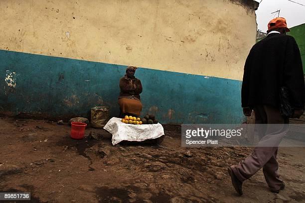 Woman sells goods along a street in Eastleigh, a predominantly Muslim Somali neighborhood on August 18, 2009 in Nairobi, Kenya. Referred to locally...