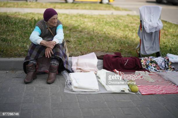 A woman sells items on a street near a flea market in a suburb of Moscow on June 17 2018 in Moscow Russia Today saw the first shock result of the...