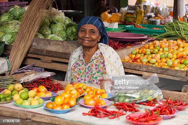 Woman sells local vegetables on a street market in Jakarta, Indonesia.