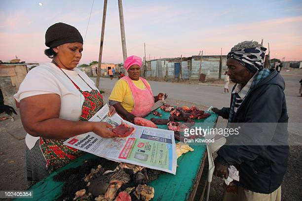 Woman sells meat to residents in the New Brighton Township on June 24, 2010 in Port Elizabeth, South Africa. The New Brighton Township was...