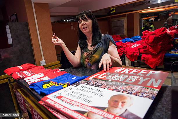 A woman sells posters and tshirts at a rally in support of Labour Leader Jeremy Corbyn by the grassroots group Momentum at The Troxy on July 6 2016...