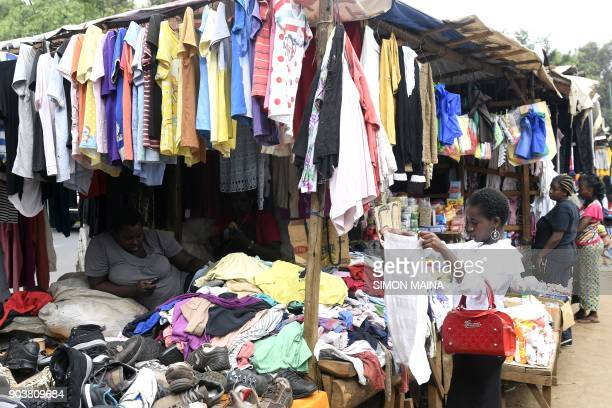 A woman sells second hand clothes in Kawangware market on the outskirts of Nairobi Kenya on January 11 2018 / AFP PHOTO / SIMON MAINA