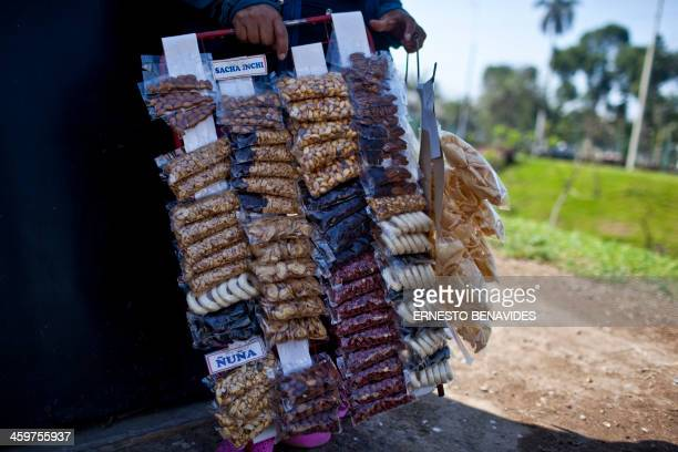 A woman sells snacks at a traffic ligth in Lima on December 27 2013 In the past few years in Peru half a dozen new local companies specialized in...