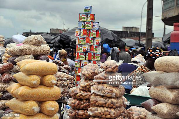 A woman sells some milk and cereals in a street market in Abobo suburb of Abidjan on July 9 on the first day of the Islamic holy month of Ramadan in...