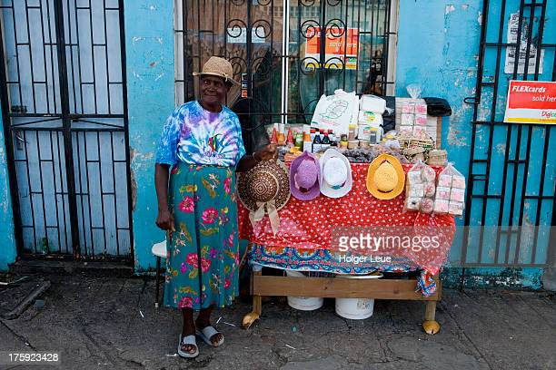 Woman sells souvenirs at street stand