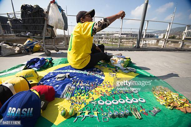 A woman sells souvenirs at the Maracana stadium in Rio de Janeiro Brazil as the preparations for the Olympics continue on June 25 2016 More than...