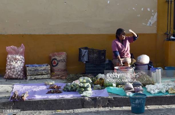A woman sells vegetables and grains in a street in Tlaxiaco Oaxaca State hometown to Mexican actress Yalitza Aparicio on February 15 2019 Aparicio...