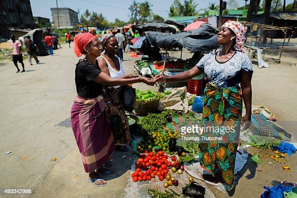 A woman sells vegetables at a street market on September 28 2015 in Beira Mozambique