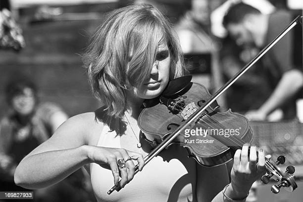 CONTENT] A woman serenades patrons with her violin skills at the Portland Farmers Market located on the campus of Portland State University Portland...