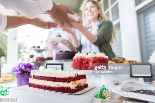 Woman serves cake during fundraiser