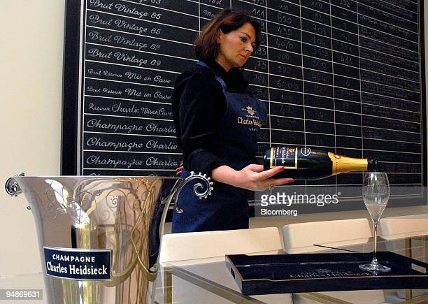 Woman serves champagne at the Piper-Heidsieck champagne factory, owned by Remy-Cointreau, in Reims, France, on Monday, July 21, 2008. Remy Cointreau...