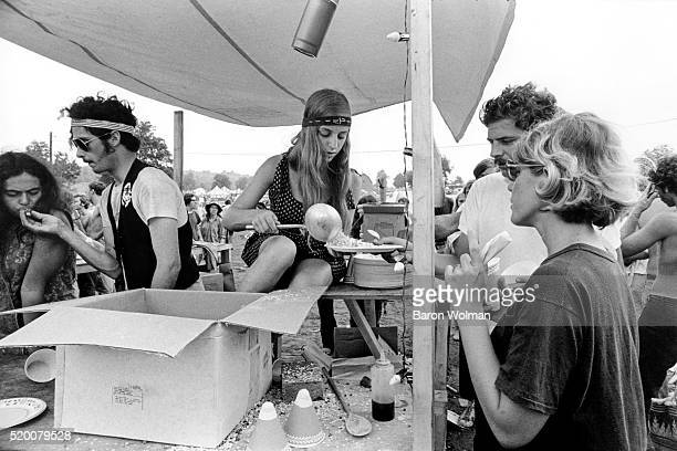 A woman serves food in a stall at the Woodstock Music Art Fair Bethel NY August 15 1969