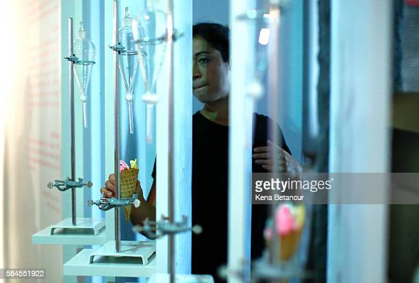 A woman serves Ice cream cones at the Museum of Ice Cream across from the Whitney Museum on July 29 2016 in New York City The temporary museum...