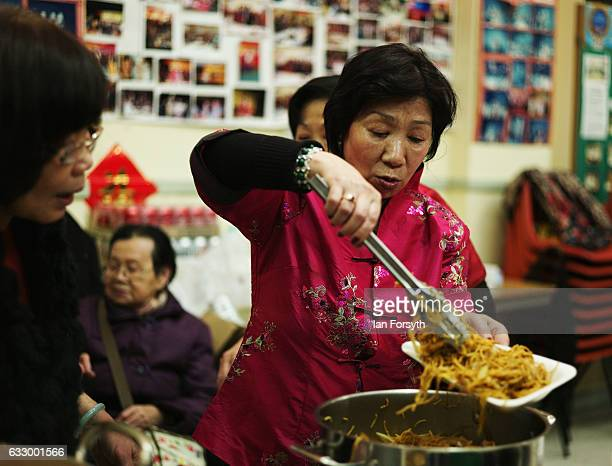 A woman serves traditional food during the Chinese New Year celebrations to mark The Year of the Rooster on January 29 2017 in Newcastle Upon Tyne...