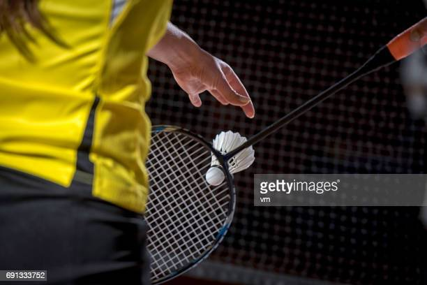 woman serving a shuttlecock - badminton stock photos and pictures